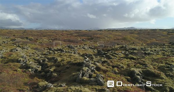 Snow Shower Over Mossy Lava Field Fall Colors Heidmork Iceland Drone Footage
