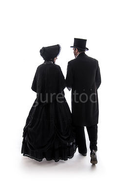 A mystery Victorian couple walking away – shot from eye level.