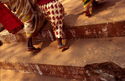 India - Kerala - Three women walk up a Hindu temple's steps