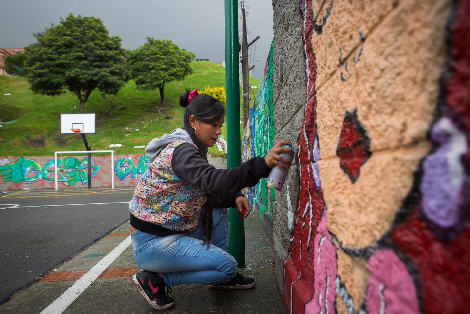 "Liza, 34 years old has been graffing for three years on the walls of the city. ""Women need to be more present, which is why I..."