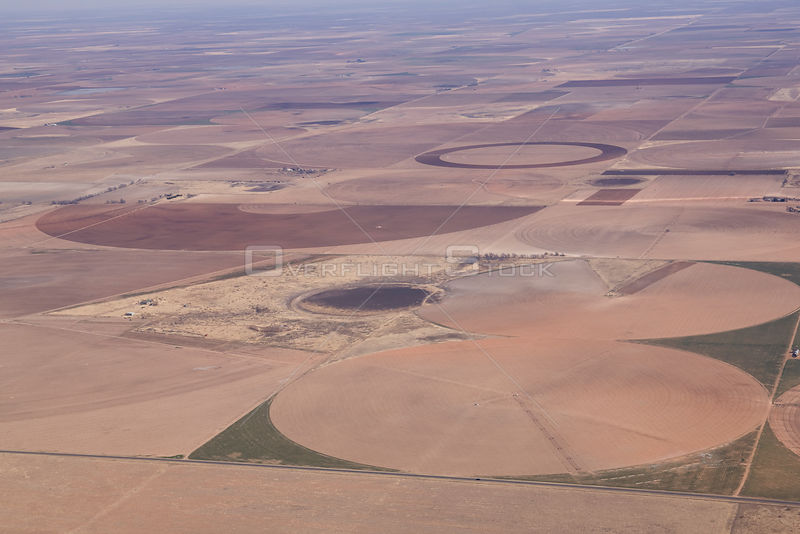 Aerial view of fields and temporary lake (playa) on high plains of Texas, USA, circles are the result of irrigation.
