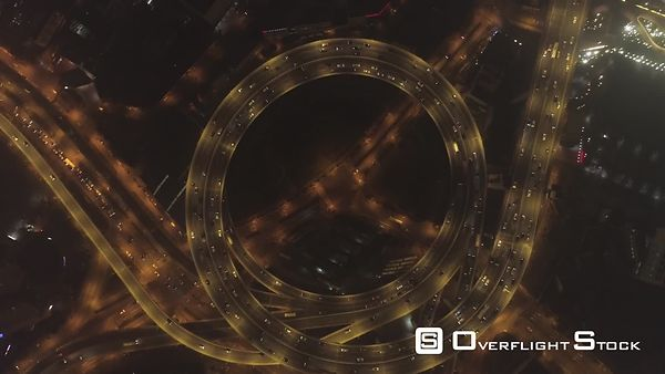 Circular Illuminated Elevated Nanpu Highway at Night. Shanghai, China. Aerial Vertical View. Drone is Flying Downward and Spi...