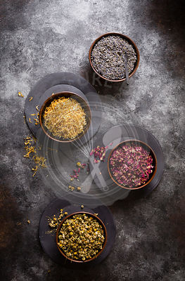 Dried flowers - Lavender,chamomile, rose and marigold on a cookie sheet background