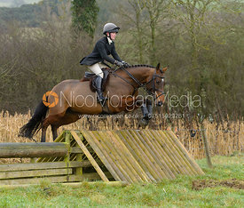 Eliza Stoddart jumping a hunt jump at Peakes - The Fitzwilliam Hunt visit the Cottesmore at Burrough House