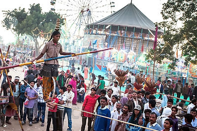 A girl walks on a tightrope during the Camel Mela in Pushkar, India.