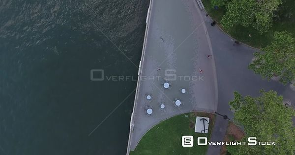 table top tracking view of the FDR Park near 12th St. and FDR. Half water, half jogging path with joggers in frame.