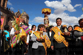Alferados / benefactors with Virgen de Natividad de Almudena during parades for Corpus Christi festival , Cusco , Peru