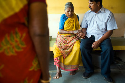 India - Cuddalore - an elderly resident talks to Saithyababu (Deputy Director of Help Age India in Cuddalore) about her sore ...