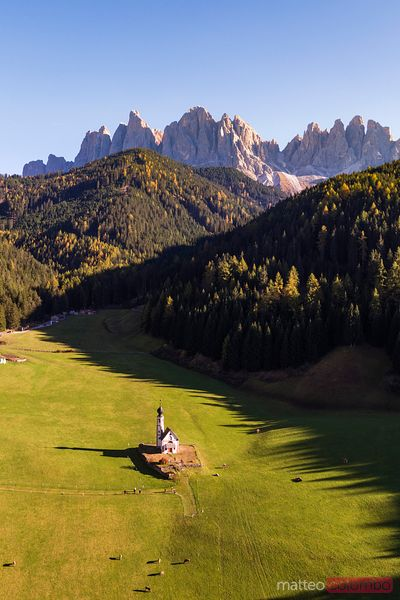 Aerial drone view of San Giovanni church, Dolomites, Italy