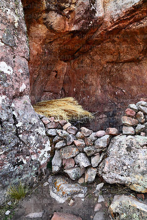 Hay being stored under rock overhang in Ciudad de Itas, Torotoro National Park, Bolivia