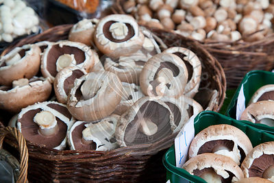 Mushrooms in wicker basket on market stall