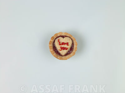 Single jam tart on white background
