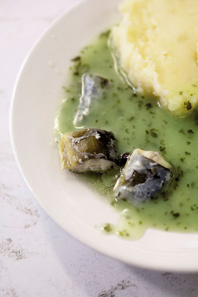 UK - London - A plate of stewed eels, mash and liquor in Manze's Eel, Pie and Mash shop on Tower Bridge Road