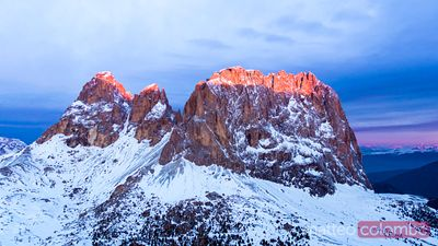 Aerial view of Sassolungo peak at sunrise, Dolomites