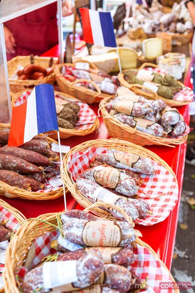 Typical french salami (saucisson) and cheese at local market, France