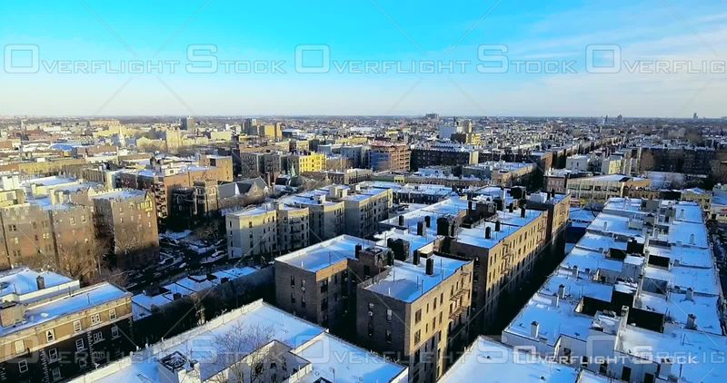 Aerial Over Snow Covered Rooftops Buildings Streets Football Fields Winter Day Brooklyn Prospect Park NYC