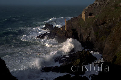 The Crown Mines at Botallack with a stormy sea.