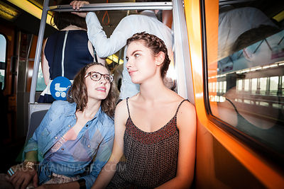 Two young women in a subway