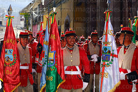 Los Colorados presidential regiment during the parade that takes caskets with remains of members of the Junta Tuitiva from San Francisco church to the cathedral during events to commemorate the uprising of July 16th 1809, La Paz, Bolivia