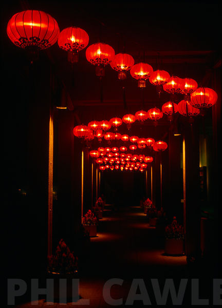 red chinese lanterns at night forming a ziz zag patern