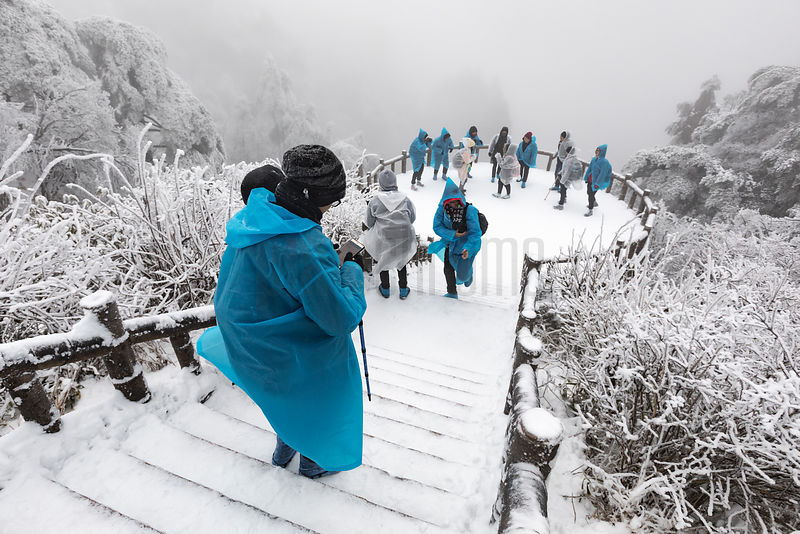 Tourists at an Overlook in the Huangshan Mountains