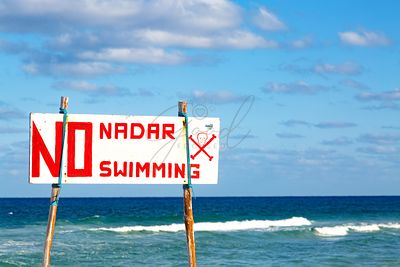 Danger No Swimming Sign At Rough Sea
