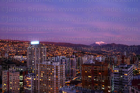 High rise buildings in Sopocachi at sunset, Mt Illimani in distance, La Paz, Bolivia