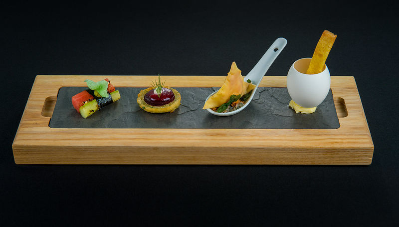 Food Shot - Tapas on a Breadboard with Black Background