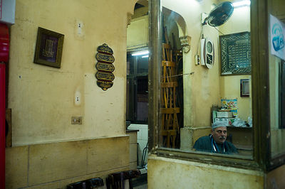 Egypt - Cairo - A man sits inside the El Nadawa El Thaqafiya cafe