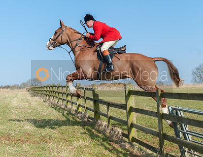 John Holliday jumping a hunt jump near the meet at Goadby Marwood
