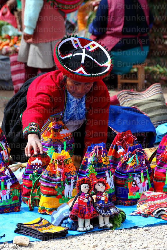 Quechua women wearing traditional dress selling textile dolls in Chinchero market, Sacred Valley, Cusco Region, Peru
