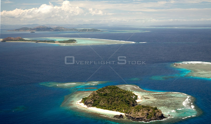 Aerial view of small islands with fringing coral reefs off Fiji, Melanesia, Pacific, September 2007