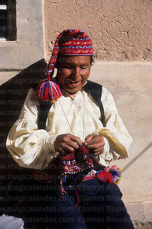 Local man knitting a wooly hat, Taquile Island , Peru