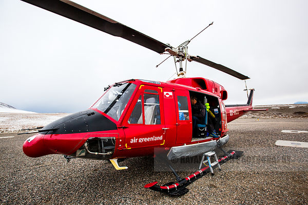 Air Greenland helicopter on the tarmac of the Qaarsut airport, ready to take off to Uummannaq