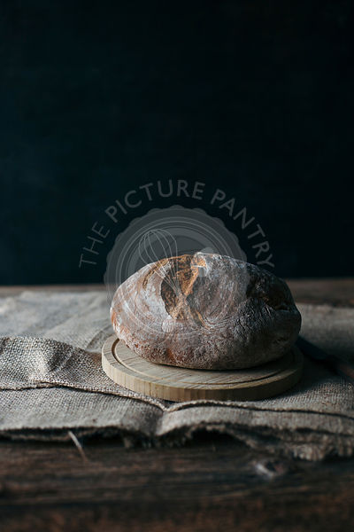Freshly baked rye bread on rustic wooden table