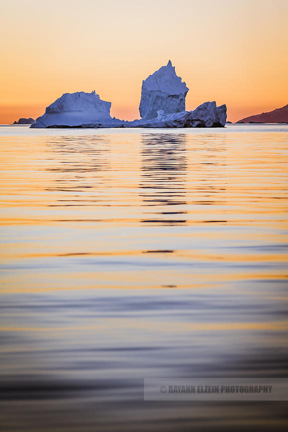 A large iceberg at sunset in the Uummannaq fjord