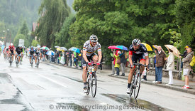 Two Cyclists Riding in the Rain - Tour de France 2014