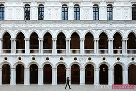 Man walking in the courtyard of Doge's Palace, Venice, Italy