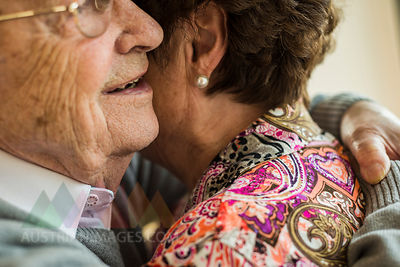 Hugging senior couple