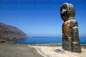 Punta Camarones and modern statue of Chinchorro mummy on headland above Bahia Camarones, Region XV, Chile