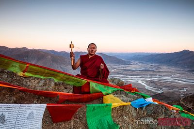 Buddhist monk praying on a mountain Tibet