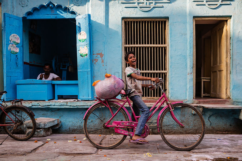 Boy on a Pink Bike in the Streets of Mathura