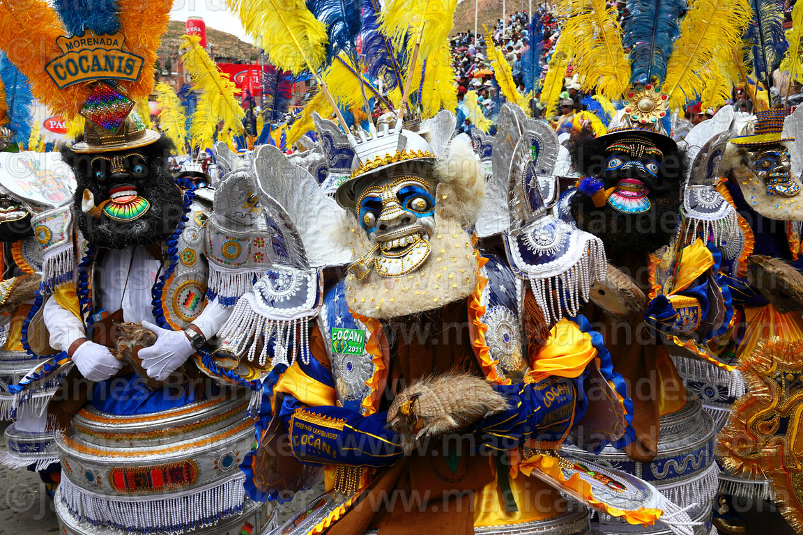 Masked Moreno Morenada dancers holding rattles made from Andean hairy armadillos, Oruro Carnival, Bolivia
