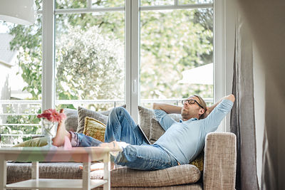 Man relaxing on couch