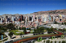 View of high rise buildings in Sopocachi district and Vía Balcón pedestrian walkway above Avenida del Ejercito, La Paz, Bolivia