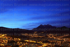 City lights in La Paz and Mt Illimani before dawn, Bolivia