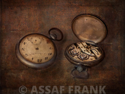 Two pocket watches, one open showing the cogs