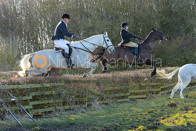 HB jumping a hedge at Town Park Farm - The Cottesmore at Town Park Farm