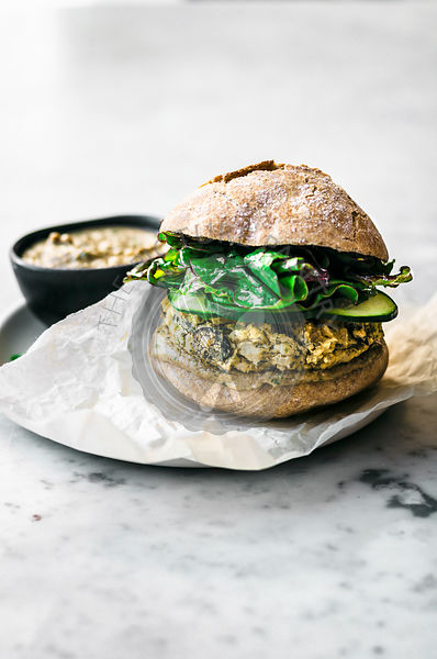 White Bean Burger with Tahini Dressing and Greens