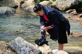 Hmong Woman Washing Clothes by River